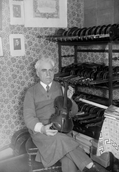 An old man, a violin maker of 'modern' Stradivarius violins. Date: 1930s