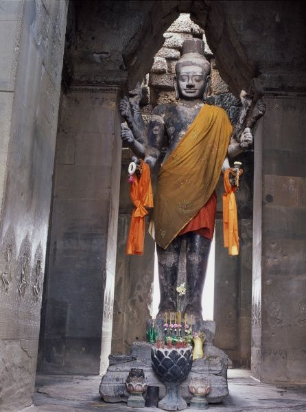 Statue of the Hindu god, Vishnu, in the Khmer temple of Angkor Wat, at Siem Reap, Cambodia. The temple was first Hindu, then Buddhist
