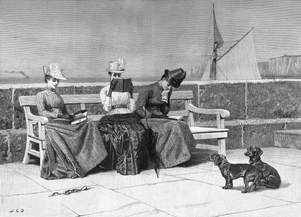 Three ladies read by the sea on a bench, observed by two small dogs. Date: 1889