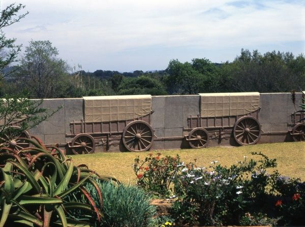Part of the Voortrekker Monument in Gauteng Province, Pretoria, South Africa, showing Voortrekker ox wagons in the wall surrounding the Monument -- in total there are 64 of these wagons, made out of decorative granite