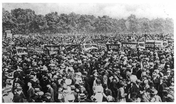 Photograph showing the scale of the Votes for Women demonstration in Hyde Park on 21 June 1908; many women and men attended; some hold banners