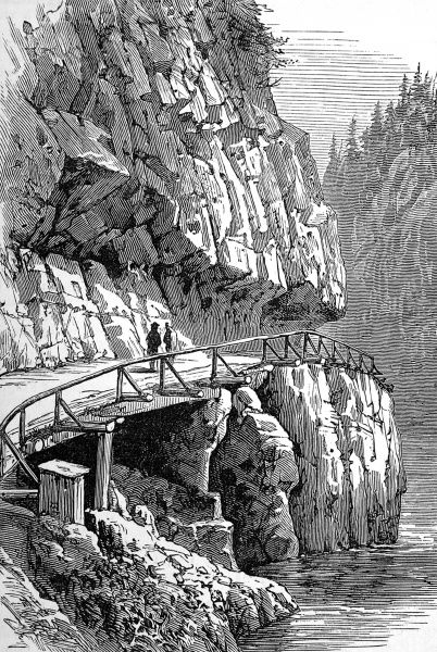 Illustration showing the rocky gorge of Chapman's Bar Bluff, with a wagon road cut out of the mountainside, British Columbia, 1882