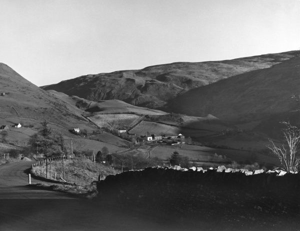 View of the valley and the tiny village of Cwmystwyth, Cardiganshire, Wales. A scenic mountain road runs from here to Rhayader. Date: 1960s