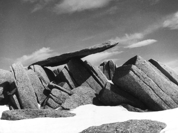 The summit of Glyder Fach, North Wales. Strewn with huge, rough volcanic boulders, this is probably the roughest summit in the country. Date: 1930s