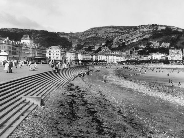 The popular seaside resort of Llandudno, Wales, with its long promenade and Victorian boarding houses and steps leading onto the beach