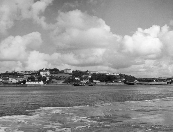 Neyland village, Pembrokeshire, Wales, viewed from the ferry which runs between Pembroke and Neyland. Date: 1950s