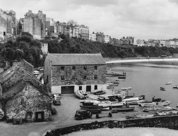 The picturesque harbour of Tenby, Pembrokshire, Wales, with the Tenby Sailing Club building in the foreground