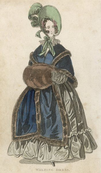 Grey dress with a single flounce & bouillon (puffing) on the skirt, lace ruff & brown fur muff & fur-trimmed pelerine-mantlet, broad brimmed bonnet with plumes
