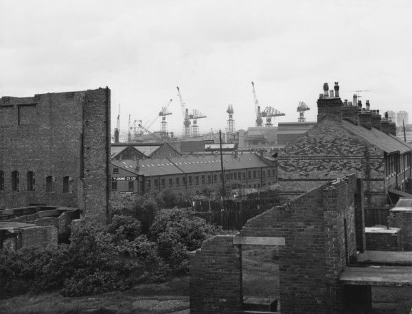 Houses and factories with cranes on the skyline in Wallsend, Tyneside