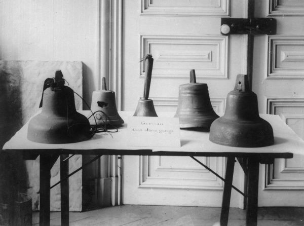 War trophies captured by the Allies during the First World War -- five alarm bells used to warn of gas attacks, taken from captured or abandoned German trenches. Date: 1914-1918