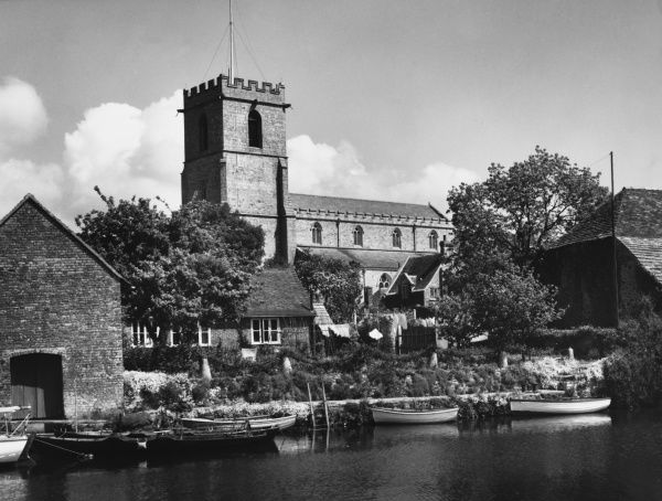 St. Mary's Church at Wareham, Dorset, overlooking the River Frome. The chancel is 14th century. Sadly, the large late Saxon nave was demolished in 1840 to make way for a new one