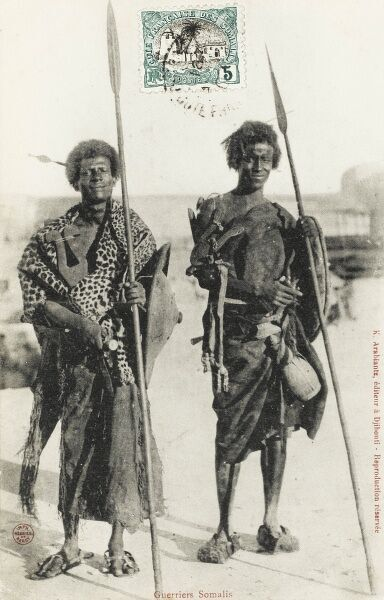 A superb photographic postcard of two 'warriors' from Somalia