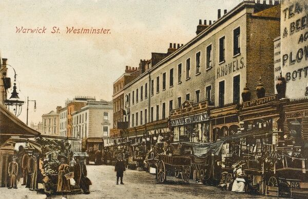 Warwick Way, Pimlico, London with a bustling street market and ornate shopfronts