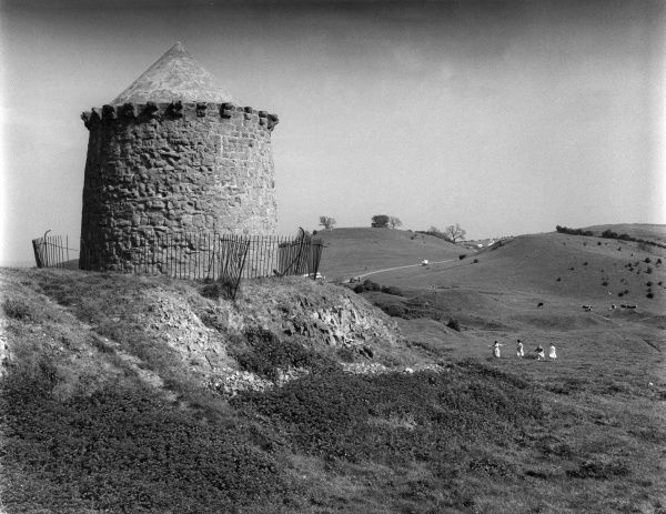 On the Burton Hills, near Burton Dassett, Warwickshire, with its old stone built ruined windmill. Date: early 1960s