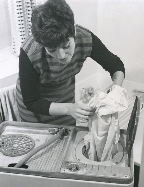A fashionable woman does some washing Date: 1960s