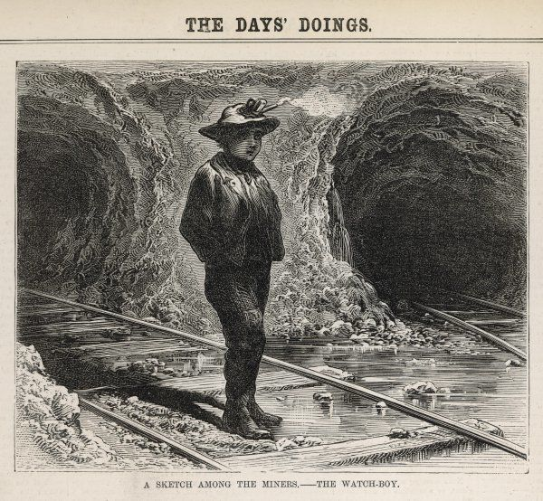 A watch boy standing at the entrance to a mine, keeping a lookout to avoid any accidents on converging tracks