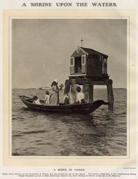A Scene in Venice A Water Shrine near Venice, Italy - a boat carries a family who bring offerings of flowers to place at the feet of the Madonna in the shrine. This family comes from one of the many fishing villages surrounding Venice. Date: 1923