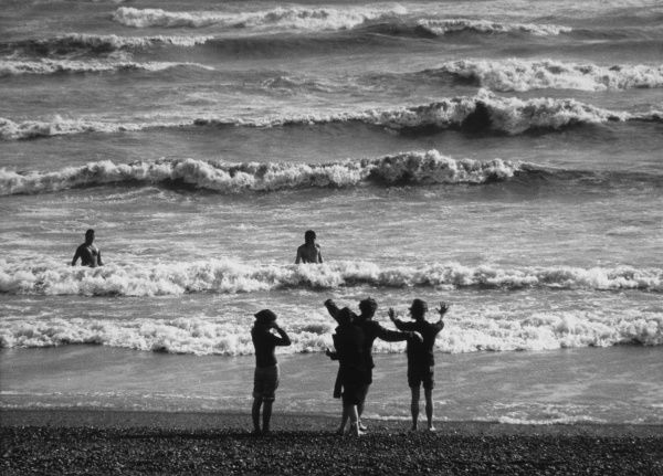Playing in the waves at Brighton, East Sussex. Date: 1974
