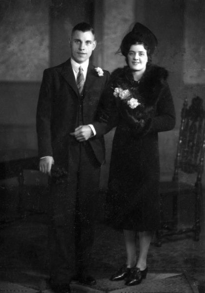 The happy couple in a wedding photo, dressed unusually in black! Date: circa 1930s