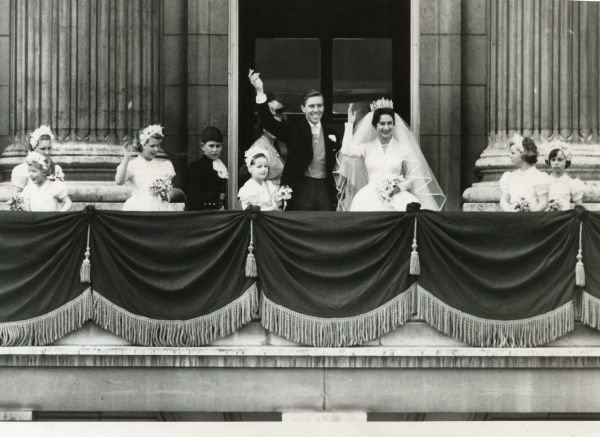 Marriage of Princess Margaret to Antony Armstrong-Jones which took place at Westminster Abbey on 6 May 1960. The couple are pictured with their bridesmaids smiling and waving from the balcony of Buckingham Palace. Date: 1960