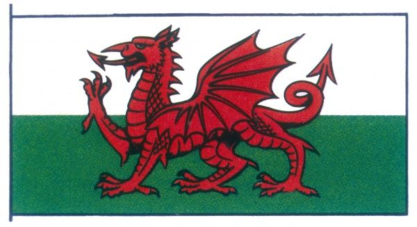 The banner of Wales features a red dragon