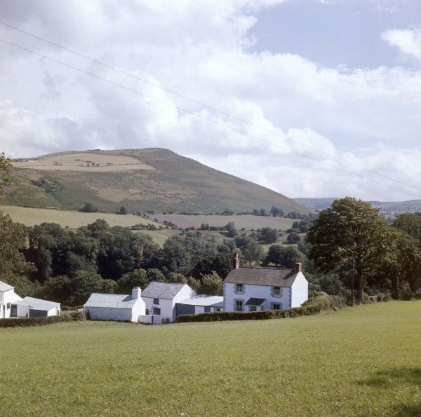 A Welsh farmstead, surrounded by beautiful hills and countryside. Date: 1960s