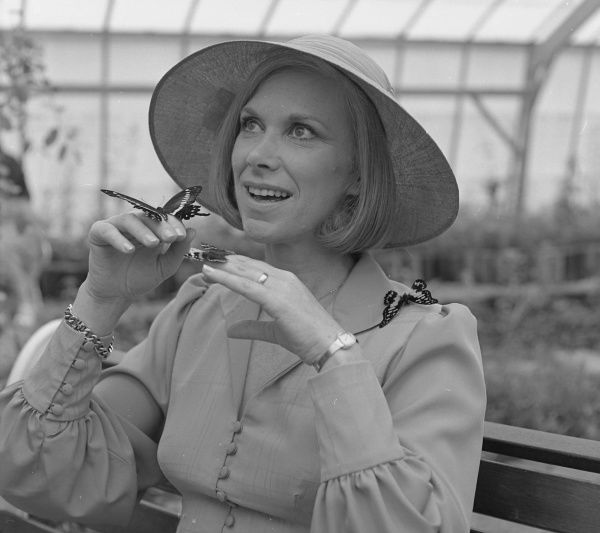 Wendy Craig (b 1934), BAFTA award-winning English actress, seen here posing with butterflies, a reference to the popular sitcom 'Butterflies' in which she starred between 1978 and 1983 as the frustrated housewife Ria Parkinson