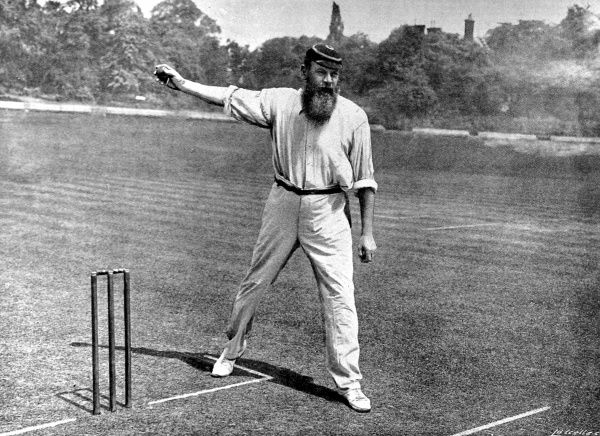 Photograph of Dr. William Gilbert Grace (1848-1915) bowling at the Crystal Palace cricket ground, London
