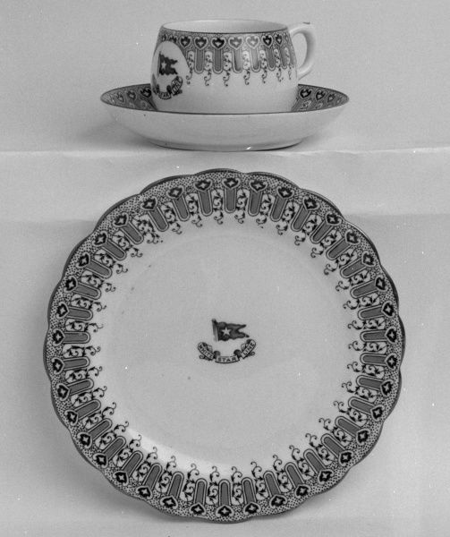 A china cup, saucer and plate bearing the White Star Line name and flag