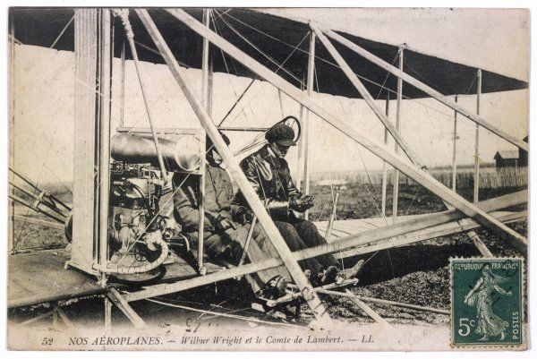 With the Comte de Lambert, at the controls of one of his biplanes, at a French aviation meeting - possibly at Pau
