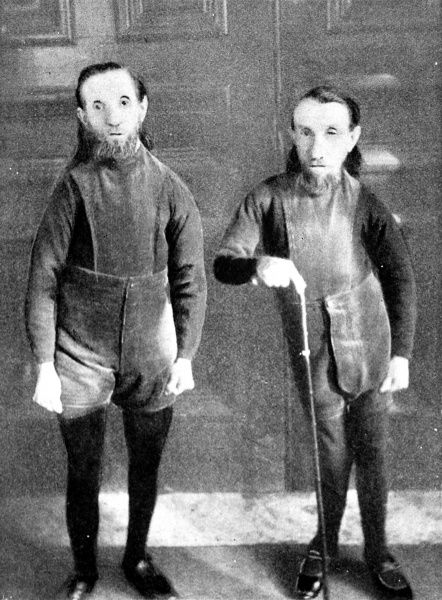 Photograph showing 'Waino' and 'Plutaino', the 'Wild Men of Borneo', pictured in 1898 when they were part of P.T. Barnum's travelling circus