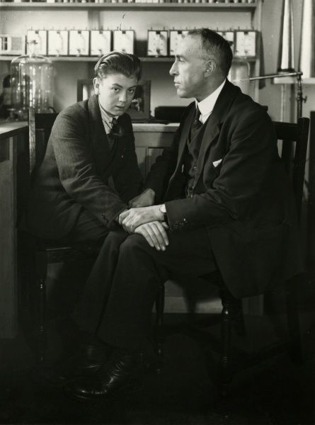 Willi Schneider when young seated with Harry Price. Willi Schneider (1903 - 1971), brother of Rudi Schneider, was an Austrian spiritualist physical medium investigated by notable psychical researchers Harry Price, Albert von Schrenck-Notzing and Eric J