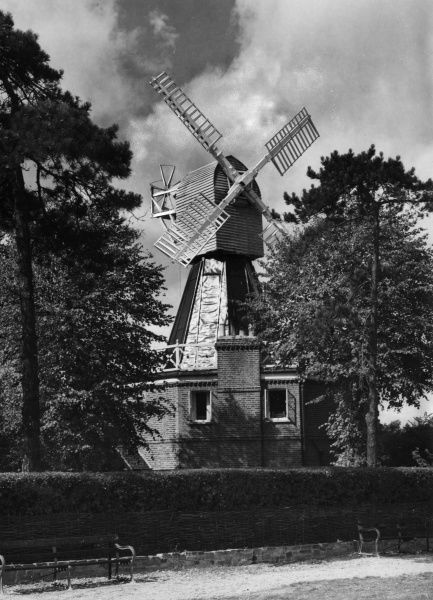 The old windmill, a feature of Wimbledon Common, London, England. Date: 1950s