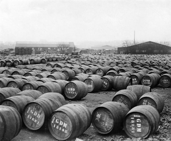 Barrels of French (Rouen) wine, rows and rows of them, as far as the eye can see... Date: 1930s
