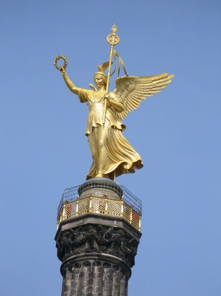 The winged bronze Victoria figure on the top of the Siegessaeule (Pillar of Victory)
