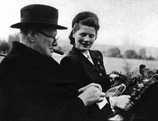 Mr. Winston Churchill with his daughter, Mary, driving to the Chateau Lohn on his arrival in Berne, where he was warmly welcomed. 1946