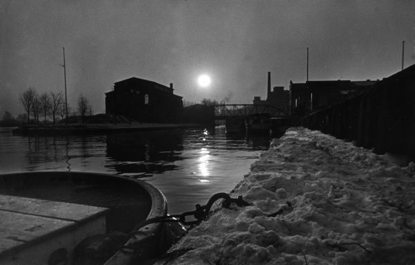 A winter sunset, with snow on the towpath of a British canal. Date: 1930s