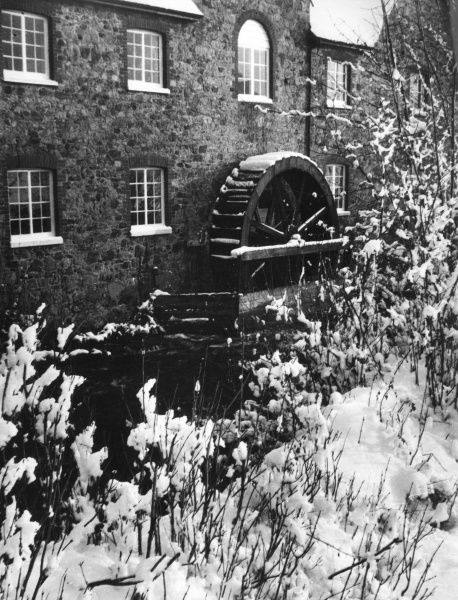 Winter snow at the old watermill at Bovey Tracey, Devon, England. Date: 1950s