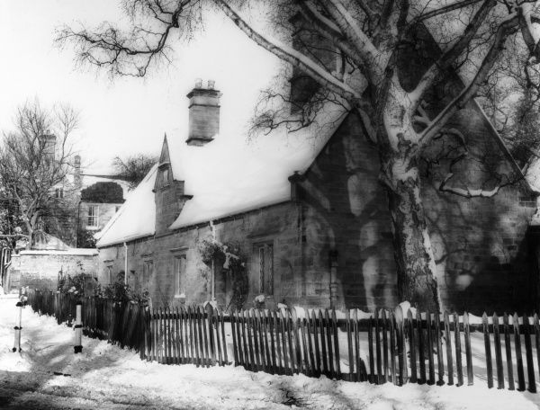 Winter view of the old almshouses at Dallington Green, Northampton, Northamptonshire, England. Date: 1960s