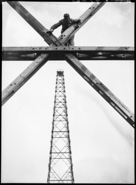 A man working on a radio mast in Berlin, Germany