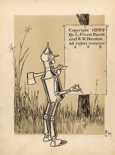 The Tin Woodman with his axe over his shoulder and an oil can in his hand
