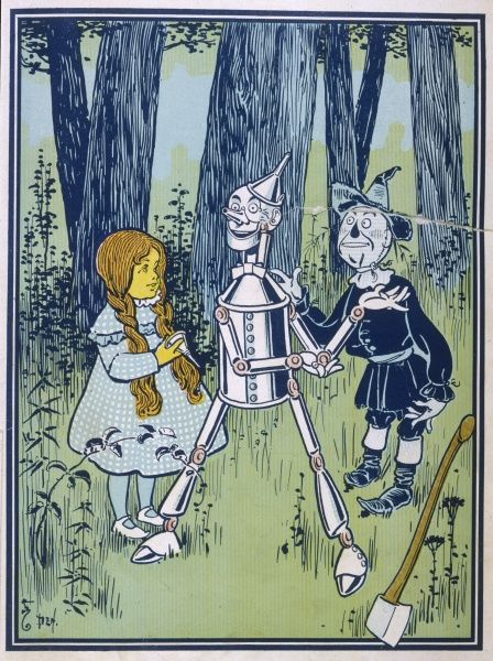 Dorothy oils the Tin Woodman's joints : 'This is a great comfort,' he says gratefully