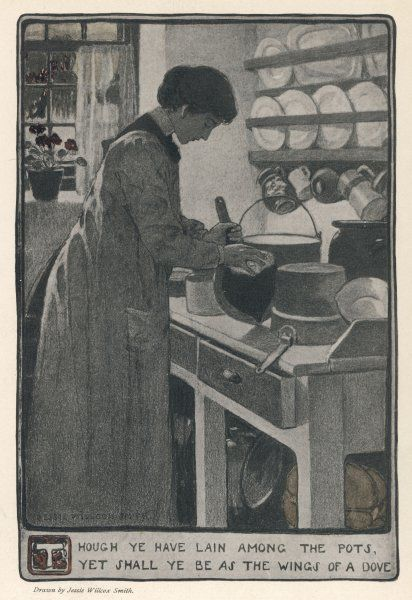 A woman cleans pans in her kitchen