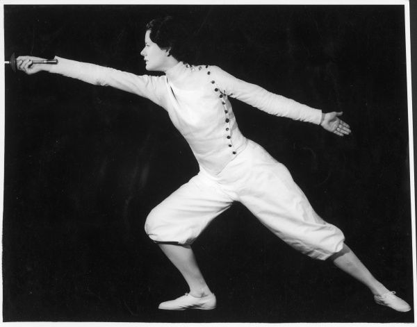 Eleanor Macdonald, the well- known fencer, demonstrates a lunge