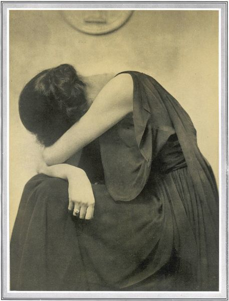 A woman holds her head in her arms in this camera study by Hugh Cecil depicting 'grief&#39