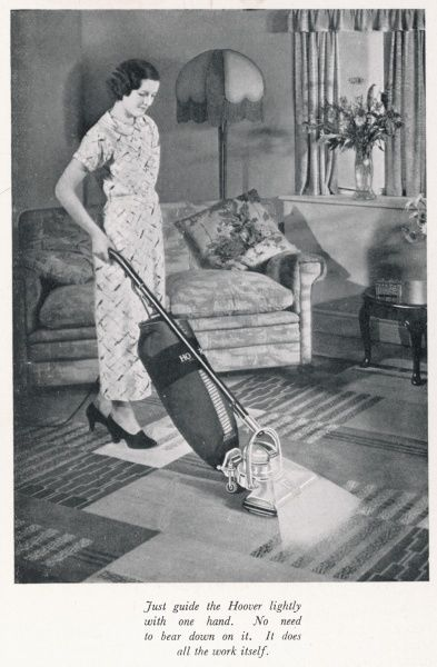 Woman hoovering in the 1930s