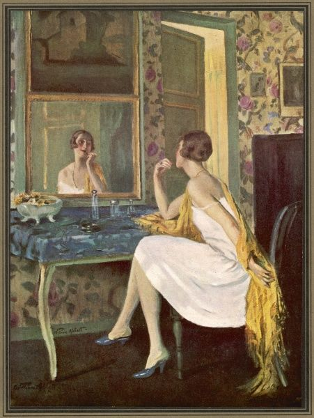 An attractive woman in a white dress, making up her face at her dressing table