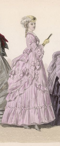A pink dress representative of the style of about 1869 - 1870. Viewed from the side the polonaise & overskirt are clearly visible