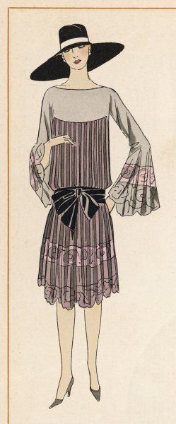 Her robe de visite is by Martial et Armand, and is made of mousseline de soie (= silk muslin)
