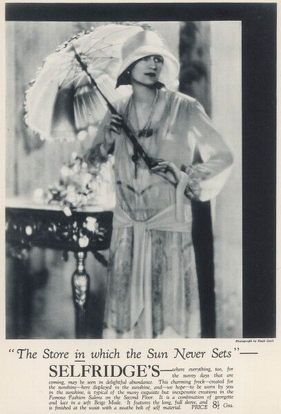 A woman poses in a summer dress with a parasol, in an advertisement for Selfridge's, the London store in which the sun never sets